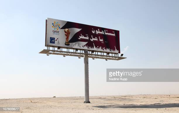 Big sign for the FIFA world cup 2022 is pictured near the desert on December 29, 2010 in Mesaid, Qatar. The International Monetary Fund recently...