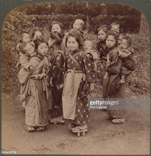 Big sisters and little brothers in the Land of the Rising Sun Yokohama Japan' 1904 From The Underwood Travel Library Japan [Underwood Underwood...