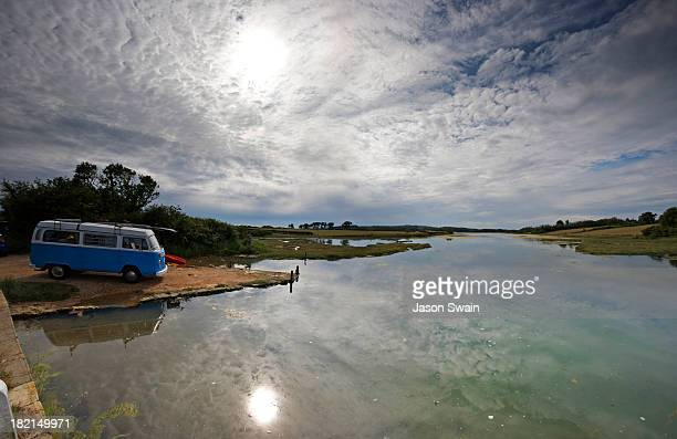Big sky, a camper van, a kayak and a lazy river. Taken at Newtown creek on the Isle of Wight.