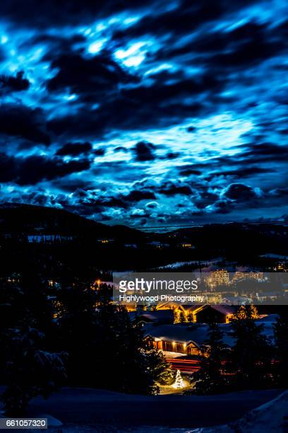 big sky montana under a snow moon sky - highlywood stock photos and pictures