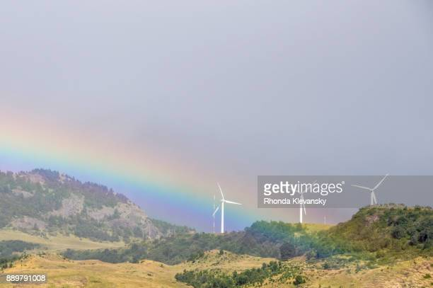 big sky rainbow over wind turbines - rhonda klevansky ストックフォトと画像