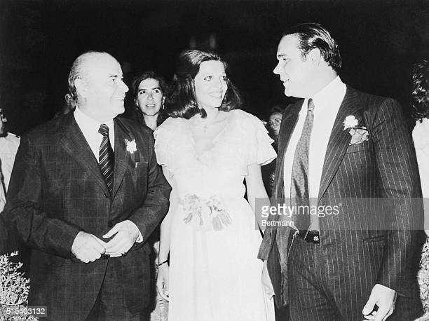 Big smiles mark the occasion as bride Christina Onassis Andreadis and her groom Alexander Andreadis chat with the groom's father Professor Stratis...
