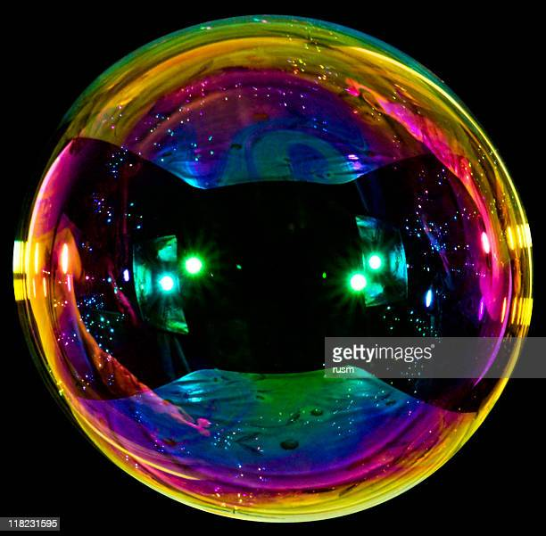 Big soap bubble on black background