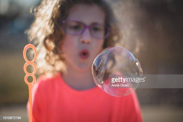 Big Soap bubble with Girl behind it
