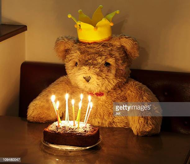big teddy bear with a birthday cake - happybirthdaycrown stock pictures, royalty-free photos & images
