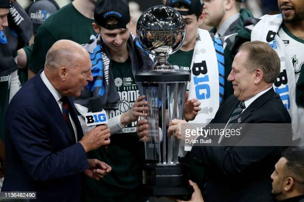 Big Ten commissioner Jim Delany presents head coach Tom Izzo the championship trophy after the Michigan State Spartans beat the Michigan Wolverines...