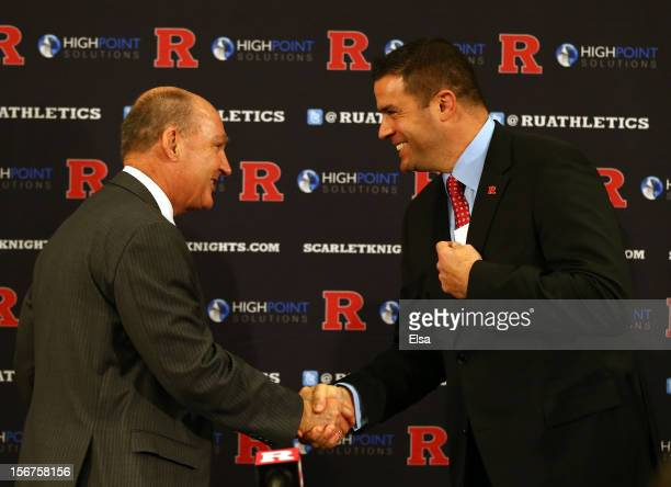 Big Ten commissioner Jim Delany shakes hands with Tim Pernetti Athletic Director during a press conference announcing that Rutgers University is...