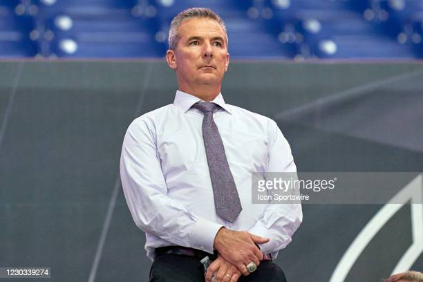 Big Ten Network analyst Urban Meyer looks on in action during the Big Ten Championship game between the Ohio State Buckeyes and the Northwestern...