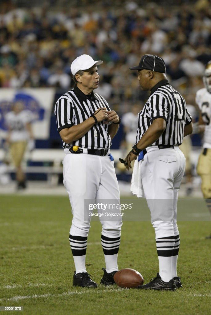 Big Ten officials, referee Dennis Lipski (L) and umpire Carl Britt, talk during a game between the Notre Dame Fighting Irish and University of Pittsburgh Panthers at Heinz Field on September 3, 2005 in Pittsburgh, Pennsylvania. Notre Dame defeated Pittsburgh 42-21.