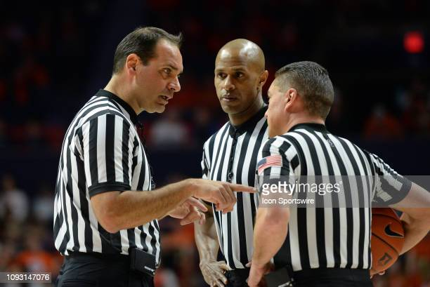Big Ten officials Steve McJunkins Rob Kueneman and Bo Boroski confer between plays during the college basketball game between the Nebraska...