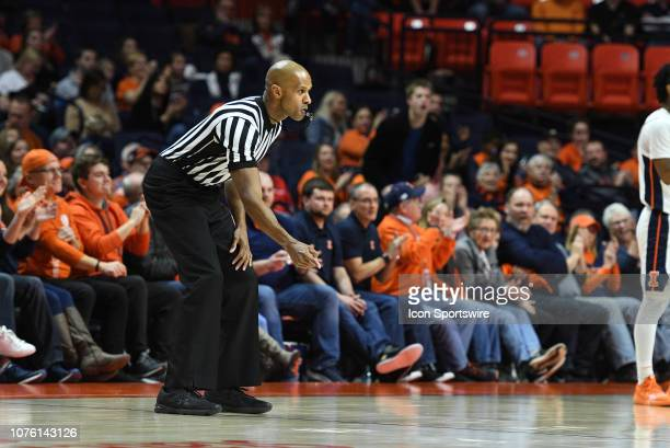 Big Ten referee Steve McJunkins signals over and back during the college basketball game between the Florida Atlantic University Owls and the...