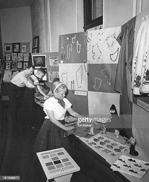 APR 19 1961 Big Things Ahead Karen Jensen sixth grader at Columbian School pre¡pares an arts and crafts exhibit for SchoolCommunity Days April 2526...