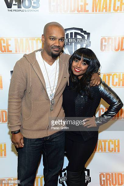 Big Tigger and Keshia Knight Pulliam attends the Grudge Match screeningat AMC Parkway Pointe on December 17 2013 in Atlanta Georgia