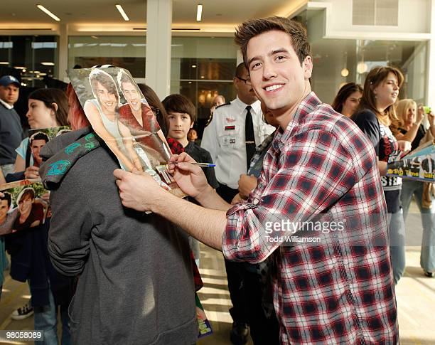 Big Time Rush members Logan Henderson signs autographs at the launch of Prom Season 2010 at JCPenney on March 25 2010 in Culver City California
