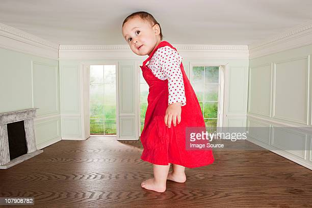 Big toddler girl in a tiny room