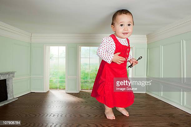 Big toddler girl in a tiny room with a key