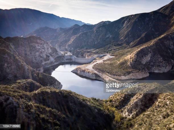 big tujunga dam- aerial drone shot - san fernando california stock photos and pictures