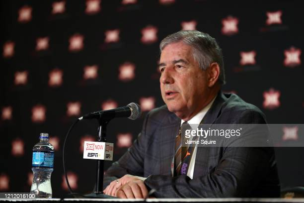 Big Twelve Commissioner Bob Bowlsby speaks to the media to announce the cancellation of the tournnament prior to the Big 12 quarterfinal game at the...