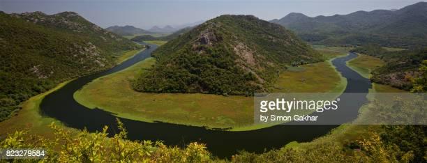 big u bend of the river rijeka crnojevica, skadar lake national park, crna gora, montenegro - letter u stock photos and pictures