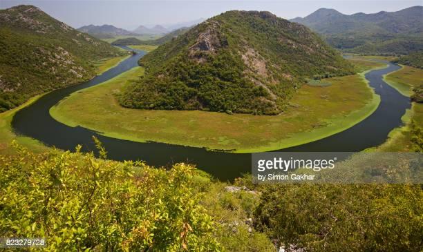 big u bend of the river rijeka crnojevica, skadar lake national park, crna gora, montenegro - rijeka stock pictures, royalty-free photos & images
