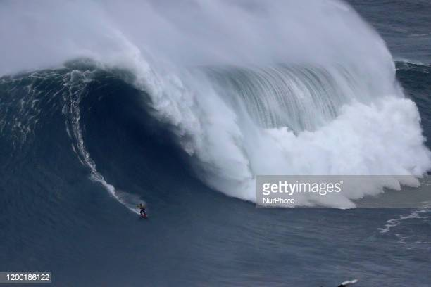Big wave surfer Axier Muniain of Spain drops a wave during the WSL Nazare Tow Surfing Challenge at Praia do Norte in Nazare, Portugal on February 11,...