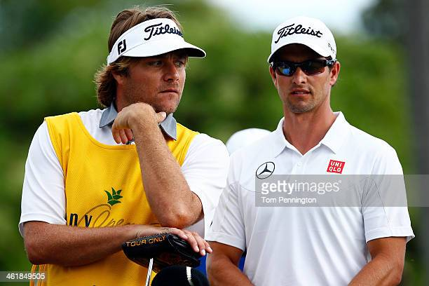 Big wave surfer Benji Weatherley caddies for Adam Scott of Australia during the third round of the Sony Open in Hawaii at Waialae Country Club on...