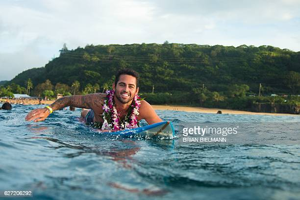 Big wave surfer Mason Ho paddles out to perform a ceremony for the opening of the 2016 Quiksilver Eddie Aikau invitational big wave contest ceremony...