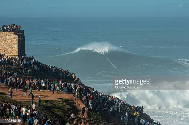 Big wave surfer Sebastian Steudtner of Germany rides a wave during a tow surfing session at Praia do Norte on October 29, 2020 in Nazare, Portugal.