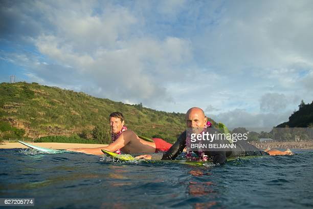 Big wave surfers Ian Walsh and Kelly Slater paddle out to perform a ceremony for the opening of the 2016 Quiksilver Eddie Aikau invitational big wave...