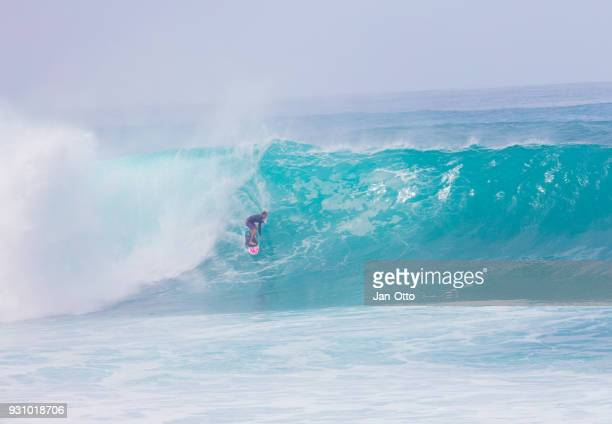 big wave surfing at north shore, oahu - banzai pipeline stock photos and pictures