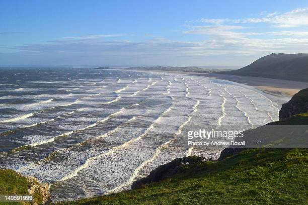 big waves at rhossili beach - gower peninsula stock photos and pictures