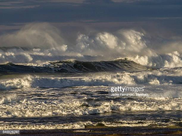 Big waves breaking on the shore of the Bay of Biscay at the beginning of a storm.