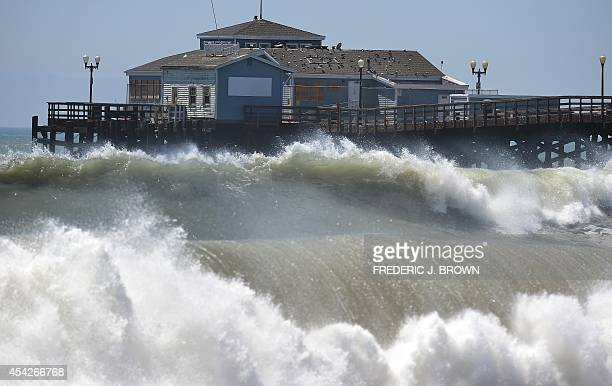 Big waves crash ashore and into the pier at Seal Beach California on August 27 where some overnight flooding occurred as the surging ocean water...