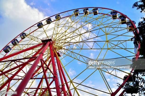 big wheel at a fun fair - bishkek stock pictures, royalty-free photos & images