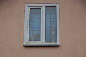 one big white window brown wall