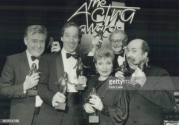 Big winners The Royal Canadian Air Farce's John Morgan Don Ferguson Luba Goy Dave Broadfoot and Roger Abbott happily clutch the Nellie statuettes...