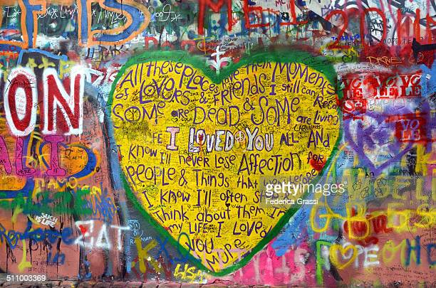 Big Yellow Heart painted by a tourist on John Lennon Wall in Prague. Everyday someone adds new paintings and writings on this wall that is now...