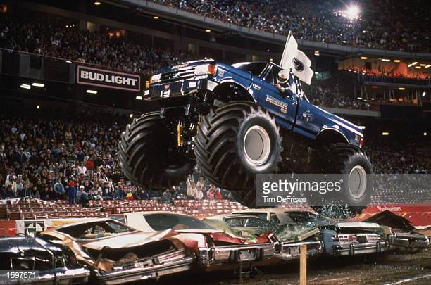 Bigfoot flies over cars during the monster truck rally at Anaheim Stadium in 1989 in Anaheim California Photo by Tim Defrisco/Getty Images