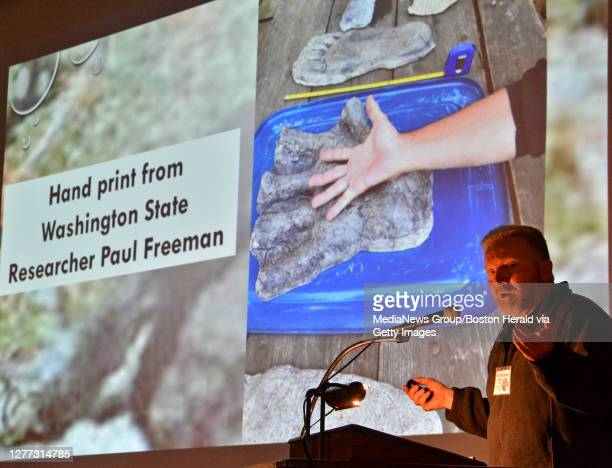 Bigfoot historian Dave McCullough shows a slide comparing a human hand against a cast of a handprint form a Bigfoot, during the Greater New England...