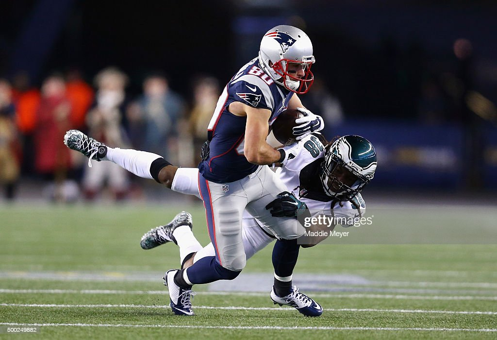 E.J. Biggers #38 of the Philadelphia Eagles tackles Danny Amendola #80 of the New England Patriots during their game at Gillette Stadium on December 6, 2015 in Foxboro, Massachusetts.
