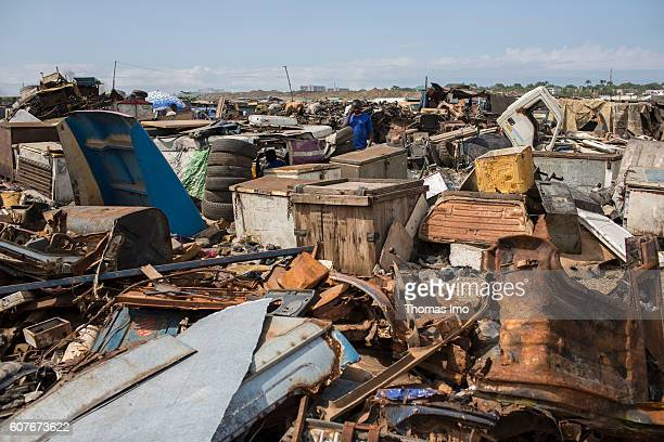 Biggest electronic scrap yard of Africa in Agbogbloshie a district of the Ghanaian capital Accra In the background an African worker is telephoning...