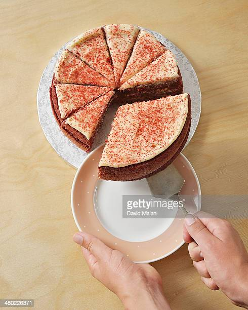 Biggest slice of cake being lifted onto plate