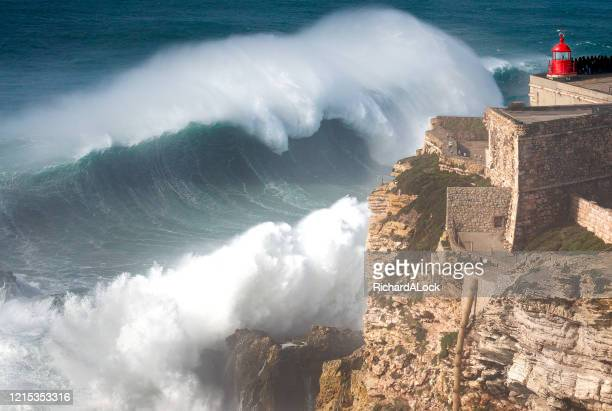 biggest wave in the world, nazare, portugal - big wave surfing stock pictures, royalty-free photos & images