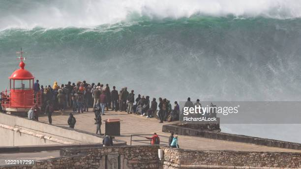 biggest wave in the world, nazare, portugal - tsunami stock pictures, royalty-free photos & images