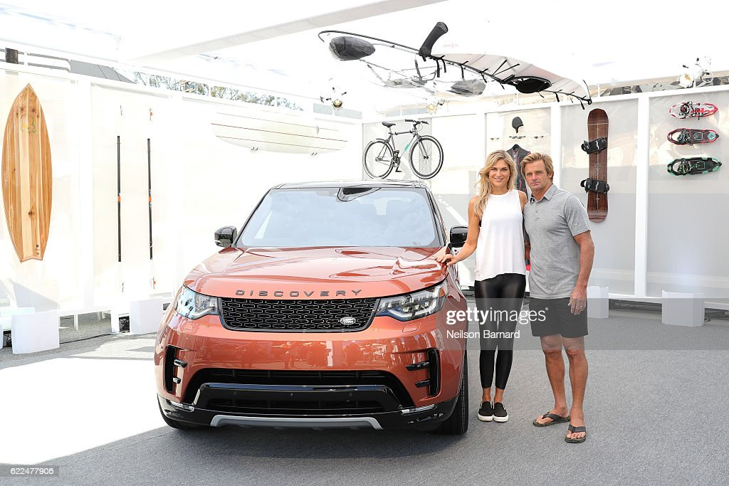 Big-wave surfer, Laird Hamilton, and champion volleyball player and fitness leader, Gabby Reece, with the all-new Land Rover Discovery SUV at the vehicle's North American debut in the iconic Venice neighborhood of Los Angeles on Abbot Kinney Boulevard on November 11, 2016 in Venice, California.