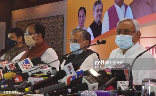Bihar Chief Minister and JDU leader Nitish Kumar and Deputy CM Sushil Kumar Modi during a press conference on seat-sharing arrangement with the NDA...