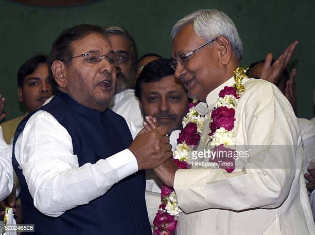 Bihar Chief Minister and newly elected JD National President Nitish Kumar being greeted by outgoing party President Sharad Yadav after the JD...