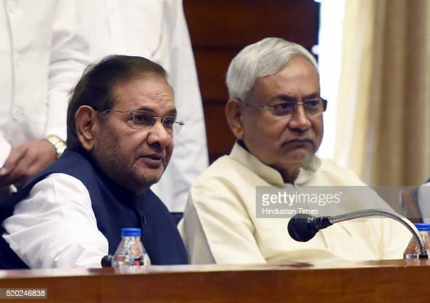 Bihar Chief Minister and newly elected JD National President Nitish Kumar and outgoing party President Sharad Yadav with others party workers during...