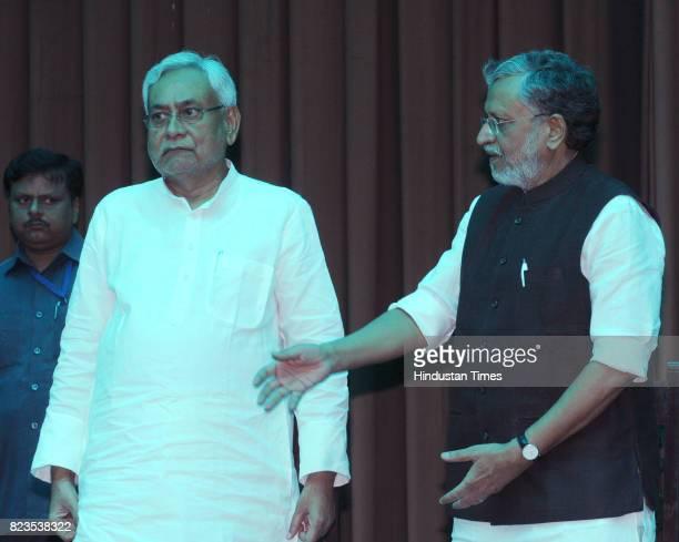 Bihar Chief Minister Nitish Kumar and BJP leader Sushil Kumar Modi after taking oath at Raj Bhawan on July 27 2017 in Patna India Nitish Kumar walked...