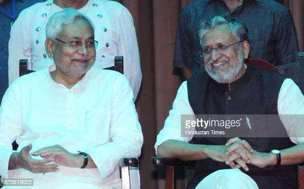 Bihar Chief Minister Nitish Kumar and BJP leader Sushil Modi after taking oath at Raj Bhawan on July 27 2017 in Patna India Nitish Kumar walked back...